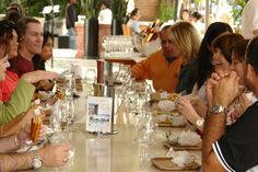People enjoying Cuban Cuisine at the South Beach food tour by Miami Culinary Tours