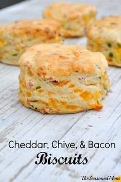 Cheddar Chive and Bacon Biscuits - good with soups: 4 ounces cheddar cheese, grated 3 tablespoons minced fresh chives ½ cup diced cooked bacon 2 cups all-purpose flour 1 tablespoon baking powder ½ teaspoon salt ¼ cup (1/2 stick) butter ¾ cup milk.