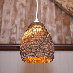 Lamp shade made of layers of cardboard...great use of old cardboard boxes.