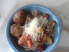 onion and beet flavored pasta with tomatoes carrots broccoli garlic onions and meatballs on the side