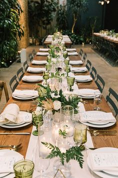 Downtown tropical jungle wedding table decor ideas with green glassware, natural wedding inspo, and geometric touches.