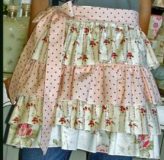 Made a 4-ruffle apron like this with an open top for hanging clothespins.  Ties in back.  Love it!