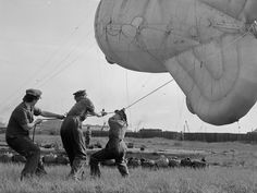 WAAF learning how to handle a barrage balloon during training.