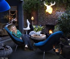 A patio transformed into a cosy outdoor living room - by Abigail Ahern