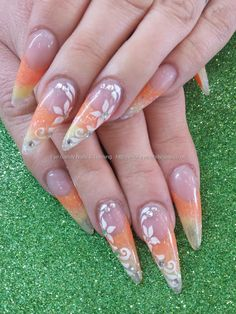 Yellow and orange acrylic fade with freehand nail art