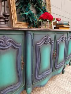 Vintage buffet refinished with Dixie Belle Paint in palmetto, bunker hill blue, and mermaid tail Facebook.com/brushedbybrandy