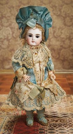 """Outstanding Sonneberg Bisque Child Doll in Superb Original Costume 14"""" (36 cm.) Marks: 116 7. Comments: Sonneberg,mystery maker,circa 1885,the model resembles the early Jumeau portrait bebe whose market it attempted to capture.:"""