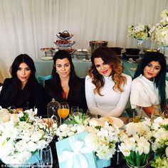 They mean business: Kim with sisters Kourtney, Khloe and Kylie Jenner at an industry lunch...
