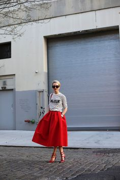 Full red skirt with striped top. Would love this if it said 'Killer' instead of 'Bonjour'.