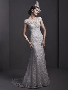 Sottero and Midgley - GEORGIA, Elaborate lace adorns this sheath wedding gown, with sparkling Swarovski crystals and pearls adorning a bateau neckline. Finished with dainty cap-sleeves and pearl button over zipper closure.