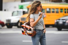 Proof jeans and a T-shirt will never steer you wrong. #refinery29 http://www.refinery29.com/2016/09/120553/nyfw-spring-2017-best-street-style-outfits#slide-29