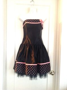 """$28.50 Jessica McClintock GUNNE SAKS STRAPLESS EVENING DRESS  SIZE 5/6. Super cute polka dot dress, strapless, with boning on sides and front, fully lined, tulle lining, back zipper,  perfect rockabilly dress, good quality, good construction! *CLASSIC BLACK SATIN WITH PINK BOW TRIM & POLKA DOTS; Black Tulle Peaking out from Hem PRINCESS SEAMS MADE IN USA *STRAPLESS *BACKLESS LINED  MEASUREMENTS LYING FLAT: ARMPIT TO ARMPIT: 15"""" WAIST: 13"""""""