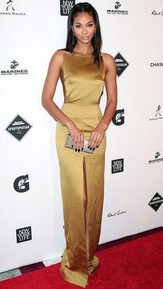 Chanel Iman in a gold satin column dress