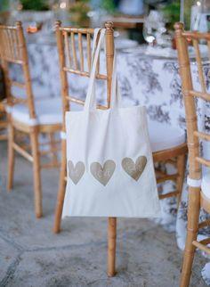 Gold Heart Gift Bag  Photography: Elizabeth Messina Read More: http://www.insideweddings.com/weddings/an-intimate-garden-themed-rehearsal-dinner-in-ojai-california/553/