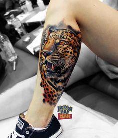 calf leopard tattoo realistic