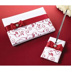 "Red & White Guest Book with Pen Set This set is covered in white satin.  The 5.25"" pen base holds a silver pen with black ink.  Both the pen base and 10"" x 6.  #timelesstreasure"