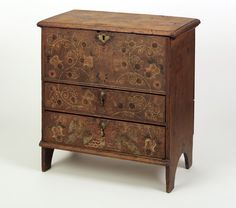 1742 American (Massachusetts) Chest of drawers at the Winterthur Museum, Delaware - Yet another example of the painted furniture from 18th century Colonial America. The colours on this one have clearly faded over time, but were they at their full vibrancy, they would have created quite a dense floral pattern.