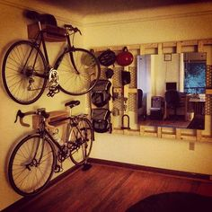Bicycle organizer made from a wood box spring bed frame.