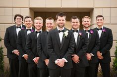 Groom & groomsmen all matchings suits. Special boutonniere for the groom // Holli B. Photography // Leslie Herring Events