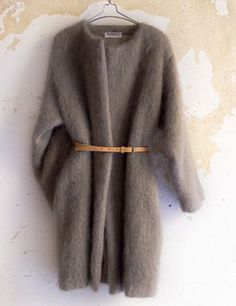 Oversized fuzzy mohair coat, made from the finest scottish brushed mohair. Round neckline, long dolman sleeves. Side seam pockets, fully lined, closes with an o