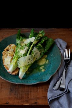 caesar........1 head of romaine lettuce (1/2 head per person, depending on size)  1 slice of ciabatta bread per person  1 small clove of garlic   1 lemon   tablespoon of dijon mustard   3 tablespoons olive oil   sea salt and fresh ground pepper  parmesan
