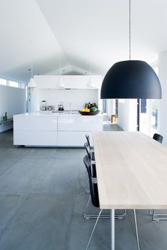 White kitchen with big floor tiles ♥