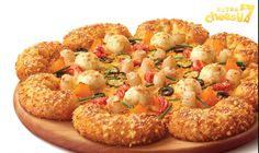 Pizza Hut Hong Kong Crayfish & Scallop Cheesy 7 Sensation Pizza, you'll find crayfish, baby scallops, cucumbers, peaches, olives, and lobster sauce.
