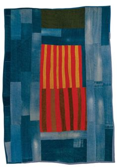 Annie Mae Young, born 1928. Work-clothes quilt with center medallion of corduroy strips, 1976. Denim, corduroy, synthetic blend, 108 x 77 inches. The Collection of the Tinwood Alliance