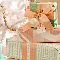 Forget Red & Green    Give your gifts decor-worthy style with patterned papers, wide satin ribbons, and clever tie-ons
