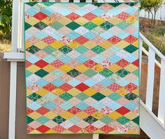 Kissing Diamonds Quilt Tutorial- Posted by Erica...You will need 217 total diamonds.  For my quilt I used 5 different colors: 45 green, 45 peach, 37 blue, 46 orange, and 44 yellow.  Some rows need 8 diamonds and some need 7 so depending on your layout you may need a couple more or less than that number.