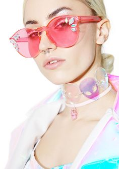 Rad and Refined Cosmic Girl Sunglasses is out to save the galaxies, bb. These supa dope sunglasses feature an acrylic, pink translucent frame with a sleek seamless design, crystal gems as embellishments, and hinged arms.