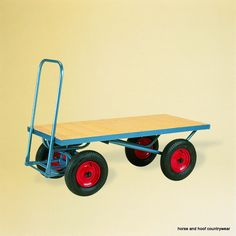 Only safety and imagination limit what can be carried on these highly manoeuverable four wheeler. Blue enamelled steel construction. Softwood boarded deck, 40cm pneumatic tyred wheels. 500kg capacity.