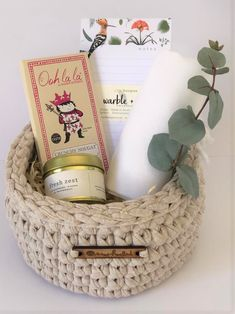 A Fresh Zest scented candle from Amanda Jayne Candle. A white Herringbone Turkish Hand Towel from The Cotton Co. A Marble and Jot Fridge Notepad from Script Design and a bar of luxurious crunchy nougat chocolate from Ooh la la! This gift is packaged in a taupe eco-friendly proudly South African crochet basket. The perfect Keepsake!Or in one of our classical gift boxes, tied with a pale pink satin ribbon.