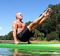 Boat press move while balancing on a stand up paddleboard.  Private Fitness Coaching, Martial Arts, & Personal Training sessions in Bluffton, SC - Hilton Head and Savannah, GA areas.  www.paddleracer.net