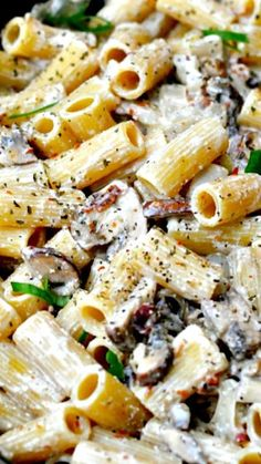 Bacon, Mushroom, Chicken Pasta Recipe ~ a creamy garlic ricotta sauce smothering hearty rigatoni pasta, with a hefty helping of mushrooms and chicken, oh and crispy bacon... Oh good gravy, it's to die for!