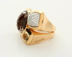 18k rose gold and white gold Valente ring with diamonds and quartz stones. Made in Italy. Approximately 0.72 ct of diamonds. Size 7 - 1/4. Accompanied by fitted box. Approximate retail is $8,060.The Valente Milano jewelry company was founded in the 1950's in Milan by Tranquille Valente.