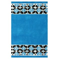 Hand-tufted rug with a geometric border.  Product: RugConstruction Material: 100% PolyesterColor:
