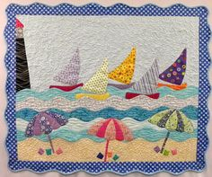 Sunday, July 12, 2015--Beachalicious by Cheryl Lynch: Transport yourself to the beach complete with sailboats and beach umbrellas while you create this wall hanging. Using both fusible and invisible machine applique, this scene goes together quickly with a full sized pattern. If you're unfamiliar with machine applique, you'll be an expert when you're done.