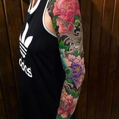 Japanese tattoo sleeve by @hori_tora. #japaneseink #japanesetattoo #irezumi #tebori #colortattoo #colorfultattoo #cooltattoo #armtattoo #tattoosleeve #girltattoo #flowertattoo #peonytattoo #butterflytattoo #wavetattoo #naturetattoo