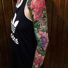 Japanese tattoo sleeve by @hori_tora. #japaneseink #japanesetattoo #irezumi #tebori #colortattoo #colorfultattoo #cooltattoo #armtattoo #tattoosleeve #girltattoo #flowertattoo #peonytattoo #butterflytattoo #wavetattoo #naturetattoo