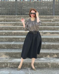 Leopard print top and pumps worn with black skirt | For more style inspiration visit 40plusstyle.com