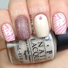 Zebra stripes. 文 Base color OPI - My Vampire Is Buff, China Glaze - United and Konad zebra stamp plate: M57. @lisa_beth