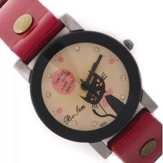 Reloj con pulsera de color rojo ,con esfera en tonos pastel y borde negro. Con dibujo de un gato echándote de menos en su esfera.