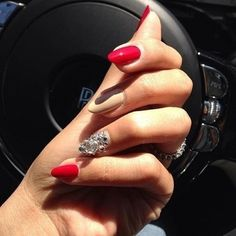 almond nails. Digging this shape and the combo of red/nude. Not that sparkle nail though.