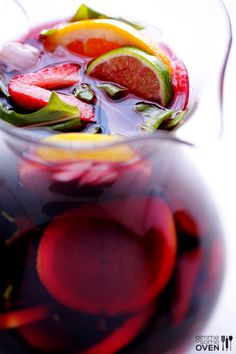 The BEST Sangria Recipe | gimmesomeoven.com 2 (750 mL) bottles dry red wine, such as M.A.N. Family Wines Cabernet Sauvignon or Porcupine Ridge Merlot 1 cup brandy 1/3 cup sugar 1/4 cup orange liqueur 1 pound DOLE strawberries, hulled and halved 3 oranges, thinly sliced 3 limes, thinly sliced 2 lemons, thinly sliced 4 cups DOLE fresh arugula (optional) 1 can lemon-lime soda