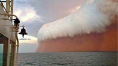 A spectacular gust front associated with cyclone Narelle was captured about 25 nautical miles north-west of Onslow in Western Australia on Wednesday. The red tinge results from dust picked up from the Pilbara. Photo: Brett Martin