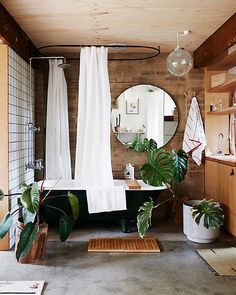 How to transform your bathroom into the ultimate home spa getaway. 8 home spa ideas to cleverly add luxury to your bathroom space with plants, bucolic elements and vibrantly patterned wall ideas. For more bathroom decor ideas go to Domino. Budget Bathroom, Bathroom Renovations, Bathroom Interior, Bathroom Furniture, Natural Living, Master Bathroom Vanity, Small Bathroom, Bathroom Things, Exposed Brick Walls
