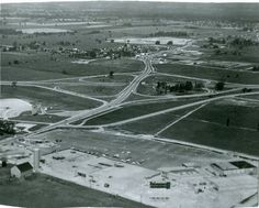 Aerial of Wellington Rd & 401 intersection, looking north; the city landscape is shown in the top of the photo (401 drive-in and Treasure Island shown), Oct 1956. (London Free Press files)