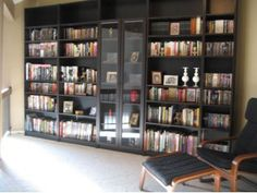 Wall of black billy bookcases