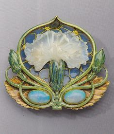 'Carnation' brooch, by René Lalique, circa 1900-1902. Gold, enamel, opal, and moulded glass.